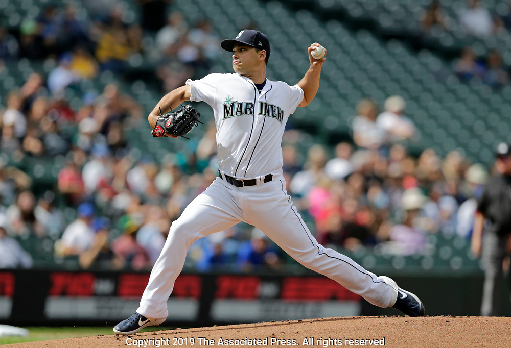 Seattle Mariners starting pitcher Marco Gonzales works against the Kansas City Royals during the first inning of a baseball game, Wednesday, June 19, 2019, in Seattle. (AP Photo/John Froschauer)