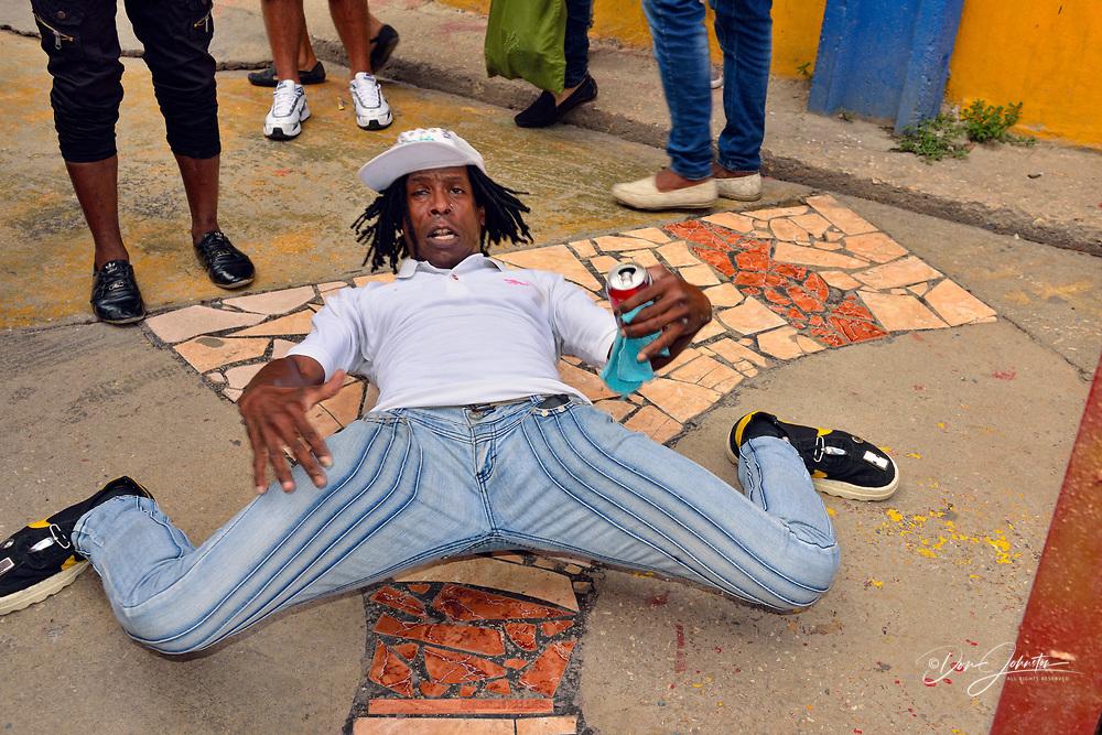 Street photography in Central Havana- Street dancer and performer at Callejón de Hamel on the Sunday afternoon rumba festival, La Habana (Havana), Habana, Cuba