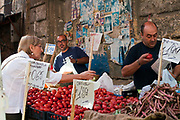 Market traders on their stall in the Capo Market, Palermo, Italy
