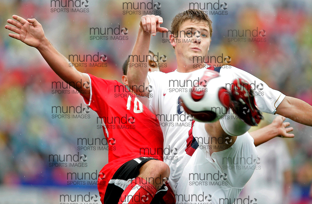 during their match at the FIFA U-20 World Cup on 14 July 2007 in Toronto, Ontario, Canada.  .AFP PHOTO/GEOFF ROBINS
