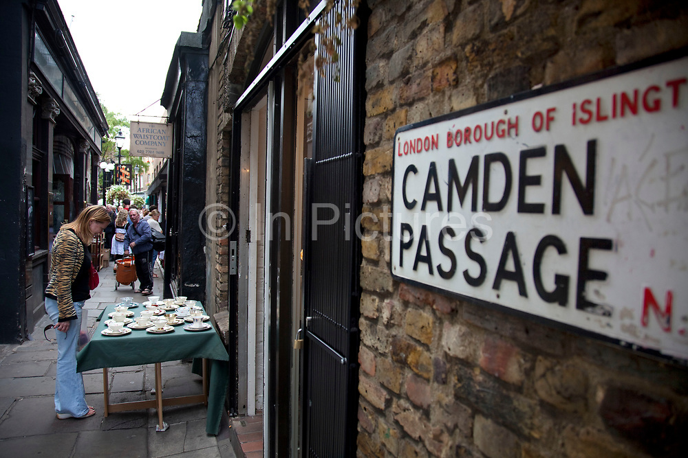 Camden Passage Antique Market near Angel, Islington, London. This historic market has stall holders selling all manner of antiquities from clothes to artifacts, objects and furniture.