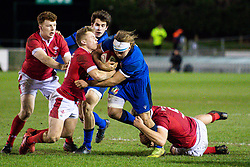 Lorenzo Cannone of Italy is tackled by Ben Carter of Wales <br /> <br /> Photographer Craig Thomas/Replay Images<br /> <br /> U20 Six Nations - Wales v Italy  - Friday 31st January 2020 - Stadiwm Zip World (Parc Eirias) - Colwyn Bay<br /> <br /> World Copyright © Replay Images . All rights reserved. info@replayimages.co.uk - http://replayimages.co.uk