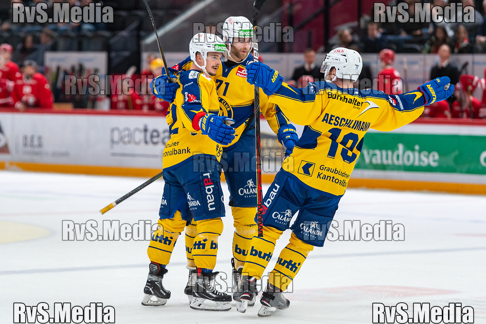 LAUSANNE, SWITZERLAND - NOVEMBER 05: #52 Otso Rantakari of HC Davos celebrates his goal with teammates during the Swiss National League game between Lausanne HC and HC Davos at Vaudoise Arena on November 5, 2019 in Lausanne, Switzerland. (Photo by Monika Majer/RvS.Media)