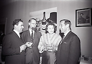 24/06/1965<br /> 06/24/1965<br /> 24 June 1965<br /> Gilbeys Ireland Ltd. reception at Gilbey's Wine Merchants, Nos. 46-49 O'Connell St., Dublin, for the presentation of a consignment of Dry Monopole Champagne to the organisers of Le Bal des Petits Lits Blancs. Image shows Mr. David I. Dand , Director, Gilbeys of Ireland Ltd.; Mr. Ralph Slazenger and Mrs Slazenger, the hosts at Powerscourt, Co. Wicklow and Mr. Ian Cairnduff, Director of  Gilbeys of Ireland Ltd., photographed at the reception.