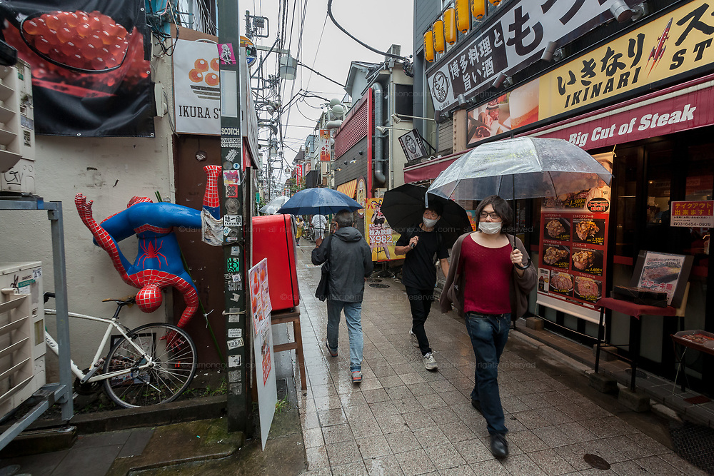 A small street with a Spiderman model on the wall of a restaurant  in Nakano, Tokyo Japan. Saturday September 26th 2020