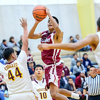 Ganado Hornet Justin Curley (23) elevates for a jump shot avocet Tohatchi Cougar Rooster Yazzie (44) during the Rehoboth Invitational basketball tournament at Rehoboth High School Friday.