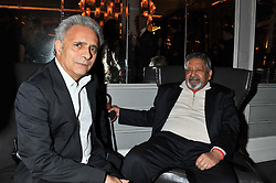 Left to right, HANIF KUREISHI and SIR V.S.NAIPAUL at a dinner hosted by Pablo Ganguli and Ella Krasner to celebrate the 10th Anniversary of Liberatum and in honour of Sir Peter Blake held at The Corinthia Hotel, Nortumberland Avenue, London on 23rd November 2011.