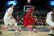 DALLAS, TX - JANUARY 4: Yanick Moreira #35 of the SMU Mustangs brings the ball up court against the Connecticut Huskies on January 4, 2014 at Moody Coliseum in Dallas, Texas.  (Photo by Cooper Neill) *** Local Caption *** Yanick Moreira