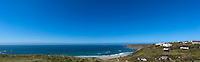 view along coastline with blue sky and sea