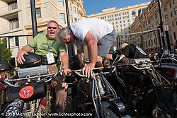 Kelly Modlin (L) of Kansas on his 1914 Excelsior next to Rick Salisbury of Utah as he climbs onto his 1916 Excelsior on the Atlantic City boardwalk at the start of the Motorcycle Cannonball Race of the Century. Stage-1 from Atlantic City, NJ to York, PA. USA. Saturday September 10, 2016. Photography ©2016 Michael Lichter.