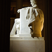 Night shot of the Lincoln statue in the Lincoln Memorial view from the side