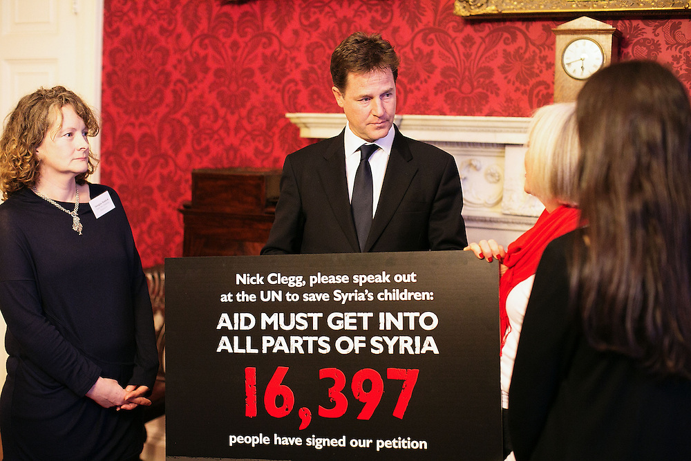From Left to Right Georgina Haddick, Deputy Prime Minister Nick Clegg, Salli Martlew & Emma Owen at Admiralty house onThursday 20, September, 2013.<br /> <br /> The three Save the Children supporters handed a petition to the Deputy Prime Minister to use his speech to the UN General Assembly to help save Syria's children.