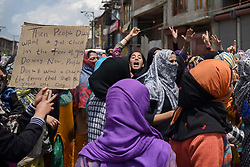 May 13, 2019 - Srinagar, Jammu and Kashmir, India - Kashmiri Protesters seen shouting slogans during a protest in Srinagar..Massive protest held in many parts of Kashmir valley against allegedly rape of three year old girl, who was raped on 09 may 2019 in North Kashmir's Bandipora district. (Credit Image: © Idrees Abbas/SOPA Images via ZUMA Wire)