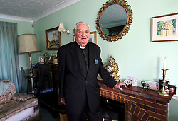"""© Licensed to London News Pictures. 01/02/2012. Uckfield, UK. BILL PETERS at home. Canon Bill Peters of Uckfield, the only chaplain who served in the Second World War still working, is celebrating his 70th year in the church as he approaches his 93rd birthday this year. It has been 67 years since he signed up with the Royal Army Chaplains Department. Canon Peters,who lives in Uckfield is awidower of 10 years and a grand-father of two, He claims he still has a lot left to achieve and said: """"If anybody wants to get married, and the parish is happy, then I do them. I do more weddings than funerals.I have been a priest for 70 years this year and I have spent all that time in Sussex, except when I was in the army and canon of a cathedral."""" Photo credit : Ron Hill/LNP NOTE TO EDITORS - WORDS AVAILABLE HERE: http://tinyurl.com/73zbhmu"""