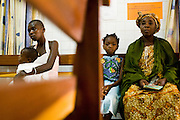 Ahoua Konante (right) waits with her seven-year-old daughter Aishata, who suffers from fever, cough and muscle pains, at the NDA health center in Dimbokro, Cote d'Ivoire on Friday June 19, 2009. At left is Kouadio Ahou Viviane with her 16-month-old boy Emmanuel Ngora Kwame.