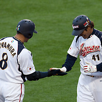 22 March 2009: #41 Atsunori Inaba of Japan celebrates with #8 Akinori Iwamura after scoring on a sacrifice fly by Johjima, Kenji #2 in the fourth inning during the 2009 World Baseball Classic semifinal game at Dodger Stadium in Los Angeles, California, USA. Japan wins 9-4 over Team USA.
