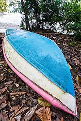 Blue-hulled boat on Biesanz Beach near Manuel Antonio National Park, Costa Rica.