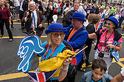 London, 10th September 2012. Olympic fans leaves the athletes' parade in the City of London. The day after the end of the London 2012 Paralympics, thousands of spectators lined the capital's streets to honour 800 of TeamGB's athletes and Paralympians. Britain's golden generation of athletes in turn said thank you to its Olympic followers, paying tribute to London and a wider Britain as up to a million people lined the streets to celebrate the ?greatest ever? sporting summer and billed to be the biggest sporting celebration ever seen in the UK.