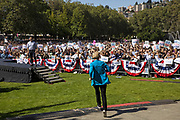 Democratic presidential candidate Elizabeth Warren, a U.S. senator from Massachusetts, jogs up to the stage for a town hall event at Seattle Center on Sunday. (Bettina Hansen / The Seattle Times)