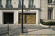 """March, 27th 2020 - Paris, Ile-de-France, France: Paris under confinement, Bonpoint, Avenue Montaigne area of high fashion, beauty, accessories, haute couture, all shops closed, in 8th arrondissement, and all public spaces virtually empty to stop the spread of the Coronavirus, during the eleventh day of near total lockdown imposed in France. The President of France, Emmanuel Macron, said the citizens must stay at home for at least 15 days, that has been extended. He said """"We are at war, a public health war, certainly but we are at war, against an invisible and elusive enemy"""". All journeys outside the home unless justified for essential professional or health reasons are outlawed. Anyone flouting the new regulations is fined. Nigel Dickinson"""