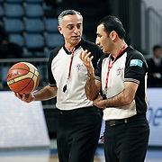 Referee's Zafer YILMAZ (L) and Sedar UNAL (R) during their Turkish Basketball league match Efes Pilsen between Tofas at the Sinan Erdem Arena in Istanbul Turkey on Sunday 27 February 2011. Photo by TURKPIX