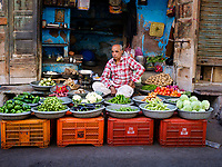 JODHPUR, INDIA - CIRCA NOVEMBER 2018: Merchant in the streets of Jodphur selling vegetables. Jodhpur is the second largest city in the Indian state of Rajasthan. Jodhpur is a popular tourist destination, featuring many palaces, forts and temples, set in the stark landscape of the Thar Desert. It is popularly known as Blue city and Sun city among people of Rajasthan and all over India