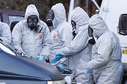 FILE PICTURE © Licensed to London News Pictures. 07/03/2018. Salisbury, UK. Police seen putting on protective suits and gas masks in preparation to carry out further investigation work in Salisbury. Former Russian spy Sergei Skripal and his daughter were taken il following a suspected poisoning in the city. The couple where found unconscious on bench in Salisbury shopping centre. Specialist units have been called in to deal with any possible contamination. Photo credit: Peter Macdiarmid/LNP