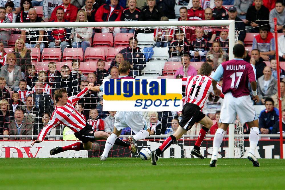 Photo: Andrew Unwin.<br />Sunderland v West Ham United. The Barclays Premiership.<br />01/10/2005.<br />West Ham's Teddy Sheringham (#8) is denied with an excellent tackle by Sunderland's Steve Caldwell (L).