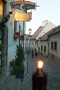 Europe, Slovakia, capitol city - Bratislava, .cobblestone paved Beblaveho lane with medieval buildings and Modra Hviezda restaurant