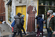 Satirical street art depicting Labour Party Leader Jeremy Corbyn dressed in a monks habit with hands together in prayer in London, England, United Kingdom.