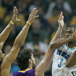 April 24, 2011; New Orleans, LA, USA; New Orleans Hornets point guard Chris Paul (3) is defended by Los Angeles Lakers power forward Pau Gasol (16) and point guard Derek Fisher (2) during the first quarter in game four of the first round of the 2011 NBA playoffs at the New Orleans Arena.    Mandatory Credit: Derick E. Hingle