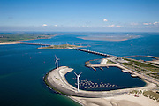 Nederland, Zeeland, Oosterschelde, 12-06-2009; Stormvloedkering tussen Noord-Beveland en Schouwen (linksboven). Onder: buitenhaven van werkeiland Neeltje Jans met het bedieningsgebouw ir. J. W. Topshuis. Midden: sluitgat Schaar, werkeiland Roggenplaat en sluitgat Hammen. Aan de horizon de zandplaat Roggeplaat, deze en andere platen worden steeds kleiner doordat de getijdewerking in de Oosterschelde kleiner is dan voorheen, de zogenaamde 'zandhonger'..Storm surge barrier in Oosterschelde (East Scheldt), between Islands of Schouwen-Duiveland and Noord-Beveland; North Sea on this side of the barrier. Under normal circumstances the barrier is open to allow for the tide to enter and exit. In case of high tides in combination with storm, the slides are closed..As a result of the reduction of tidal height no new sand is deposited on the sand bars which slowly erode, causing environmental problems.Swart collectie, luchtfoto (25 procent toeslag); Swart Collection, aerial photo (additional fee required).foto Siebe Swart / photo Siebe Swart