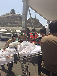 Sept. 24, 2015 - Mina, Saudi Arabia - Emergency workers help the injured near the Saudi Arabia's holy Muslim city of Mecca. A stampede during one of the last rituals of the Hajj season, the annual Islamic pilgrimage to Mecca has killed more than 700 people and injured 800 others in Saudi Arabia. The stampede occurred Thursday morning during the ritual known as 'stoning the devil' in the tent city of Mina, about 2 miles from Mecca, Islam's holiest city. (Credit Image: © Sabaq/Xinhua via ZUMA Wire)