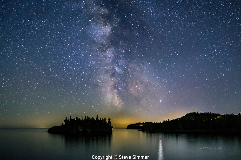 A late September evening and clear skies.  The Milky Way center will set within the hour. Jupiter on the right casts a bright reflection on Lake Superior.