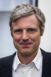 © Licensed to London News Pictures . FILE PICTURE DATED 01/10/2013 of ZAC GOLDSMITH MP at a debate on the environment at the Conservative Party Conference in Manchester , as the Conservative MP has threatened to quit the party if it commits to a third runway at Heathrow Airport in the next election manifesto . Mr Goldsmith , whose constituency of Richmond Park would be directly affected by any expansion of Heathrow Airport , said that if the government reversed its previous decision not to expand Heathrow Airport , he would trigger a by-election . Photo credit : Joel Goodman/LNP