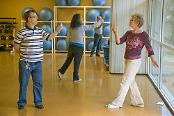 Day Service Officer leading a dance class for people with learning disabilities,