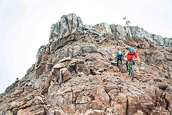 "Oct 26, 2016 - Mount Kenya, Kenya - Swiss-American HANS REY and German GERHARD CZERNER ride down from the peak of Mount Kenya. Professional mountain bike riders Hans Rey, Danny MacAskill and Gerhard Czerner are the first to take on Africa's two highest mountains back to back on mountain bikes. On Oct 26th Rey and Czerner summit Africa's second tallest mountain, Mount Kenya's Point Lenana (4,985m/16,355ft) with their mountain bikes. On November 3rd, only one week later, together with urban trials YouTube sensation Danny MacAskill; they also summited Mount Kilimanjaro (5,895m/19,340ft), the Roof of Africa. There have only been a handful of people who have taken their bikes to either Mount Kilimanjaro or Mount Kenya in the past, but none have achieved both, one straight after the other. Others carried their bikes for the majority both up and down the mountains, while Rey (Swiss/American), MacAskill (Scottish) and Czerner (German) rode 98% of the descent. They are world renown extreme bikers and their feats will be featured in a TV documentary, magazine stories and an upcoming film about the Mountain Bike Freeride history, titled ""Nothin For Free"" produced by Freeride Entertainment. The hardest part about the trip was adjusting to the high altitude. The terrain is extremely technical and challenging, several different eco-systems are being crossed on the way, from rainforests to glaciers. It took the riders 4 days to summit and traverse Mount Kenya, and 6 days to summit and descend Mount Kilimanjaro. The National Parks plan on extending their programs to permit bike riders in the future. For those that dare, there are adventures and ultimate challenges both physically and mentally awaiting them. (Credit Image: © Martin Bissig via ZUMA Wire)"
