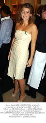 Social figure MISS AMBER NUTTALL at a party in London on 4t September 2003.PME 133