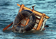 8/1994-Al Diaz/Miami Herald-- Despite the pounding sea, this Cuban rafter was determined to leave on his raft as he tries to keep it under control. It overturned but he righted his raft and tried again as he prepared to leave the Cojimar coast of Cuba. In 1994 Cuban balseros turned the tiny fishing village into a major point of embarkation for thousands seeking a better life.