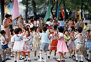 Chinese children attending a cultural display in Canton, China in the 1980s