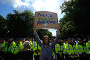 Police and protesters outside the drilling site run by Cuadrilla Resources, near Balcombe in South East England. Anti fracking protesters scuffled with police outside the gas exploration site.