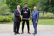 FAW press conference with Wales National football Team Manager, Chris Coleman © as he signs a new extension to his contract with FAW Chief Executive Jonathan Ford ® and FAW President David Griffiths (l)  at the Vale Resort Hotel in Hensol, South Wales on Monday 23rd May 2016.<br /> pic by Andrew Orchard, Andrew Orchard sports photography.