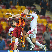 Galatasaray's Burak Yilmaz (L) during their Turkish Super League soccer match Galatasaray between Sivasspor at the TT Arena at Seyrantepe in Istanbul Turkey on Friday, 26 September 2014. Photo by Kurtulus YILMAZ/TURKPIX