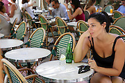 a tiered tourist at le cafe, outdoor restaurant, Saint-Tropez, France. MR for main subject