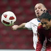 Galatasaray's Juan Pablo PINO (R) and Trabzonspor's Serkan BALCI (L) during their Turkish superleague soccer derby match Galatasaray between Trabzonspor at the TT Arena in Istanbul Turkey on Sunday, 10 April 2011. Photo by TURKPIX