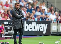 Football - 2019 / 2020 Premier League - West Ham United vs. Norwich <br /> <br /> Daniel Farke [GER], Manager of Norwich City,  looks on as his team fall behind at the London Stadium<br /> <br /> COLORSPORT/DANIEL BEARHAM