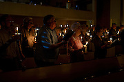 Visitors remember Ebola patient Thomas Eric Duncan in a memorial service at Wilshire Baptist Church on October 8, 2014, in Dallas. (Cooper Neill for The New York Times)