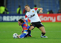 Football - Champions League - FC Basel vs. Manchester United<br /> Nemanja Vidic of Manchester United gets his leg trapped under Marco Streller of FC Basel and is subsequently stretchered off at St. Jakob Park, Basel