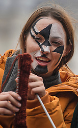 © Licensed to London News Pictures. 07/10/2019. London, UK. An Extinction Rebellion activist does some knitting while sat on a wooden structure in Trafalgar Square, Westminster. Activists will converge on Westminster blockading roads in the area for at least two weeks calling on government departments to 'Tell the Truth' about what they are doing to tackle the Emergency. Photo credit: Ben Cawthra/LNP