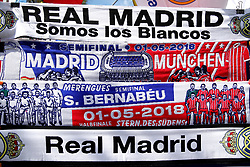 Commemorative scarfs of the match are seen on display outside the grounds of the stadium before the match begins